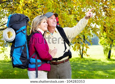 Senior tourists couple hiking at the park. - stock photo