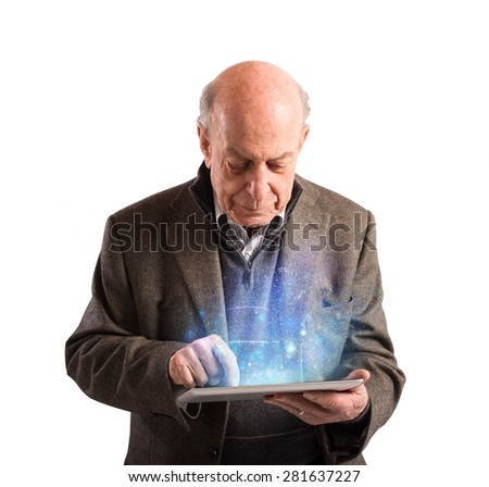 Senior uses tablet to surf the internet - stock photo