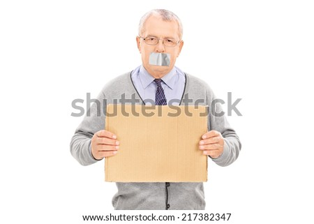 Senior with duct taped mouth holding a blank sign isolated on white background - stock photo