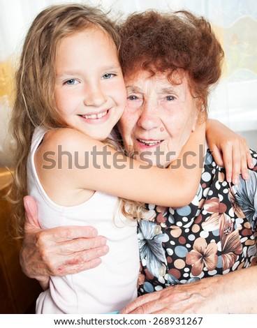 Senior with girl. Generation. Elderly woman with great-grandchild - stock photo