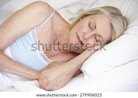 Senior Woman Asleep In Bed - stock photo