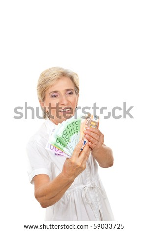 Senior woman counting money isolated on white background ,copy space for text message - stock photo