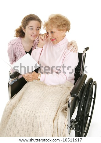 Senior woman crying as she reads a card from her granddaughter.  Isolated on white. - stock photo