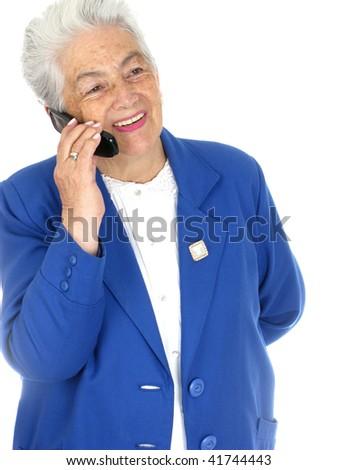 Senior woman enjoying a cell phone conversation isolated over white background - stock photo