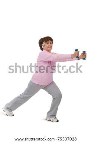 senior woman exercising in gym with dumbells - stock photo