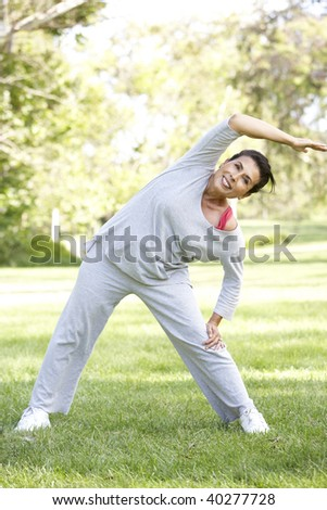 Senior Woman Exercising In Park - stock photo