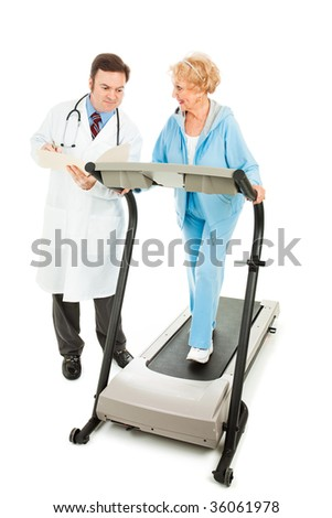 Senior woman exercising on a treadmill while her doctor monitors her progress.  Full body isolated. - stock photo