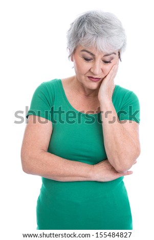Senior woman feeling toothache or thinking about her sad life. - stock photo