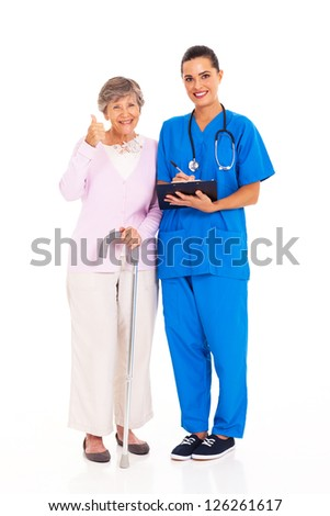 senior woman giving thumb up to medical service - stock photo