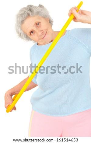 senior woman gymnastic exercises with hoop on white background  - stock photo