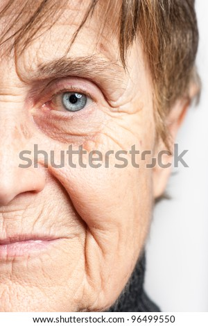 Senior Woman half face - stock photo