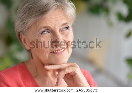 Senior woman happy at home - stock photo