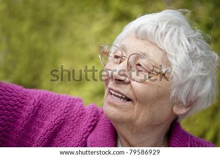 Senior woman happy outdoor portrait - stock photo