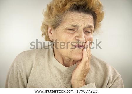 Senior woman having teeth ache. Portrait - stock photo