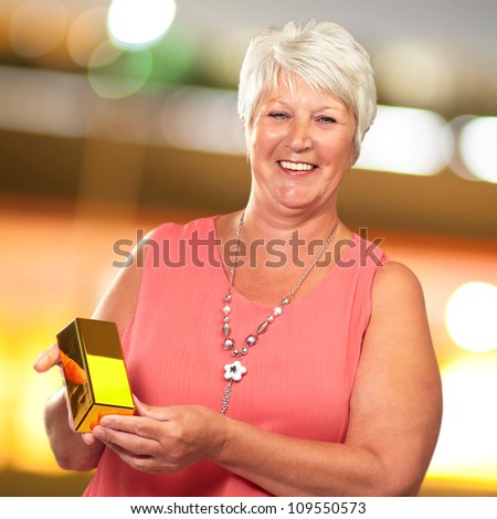 Senior Woman Holding gold, Outdoor - stock photo