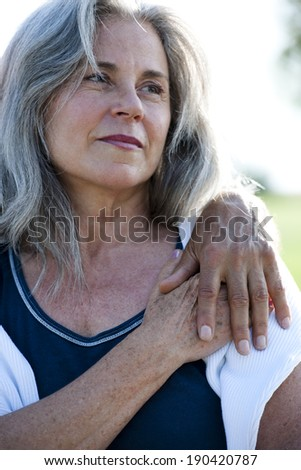 Senior woman holding her man's hand - stock photo