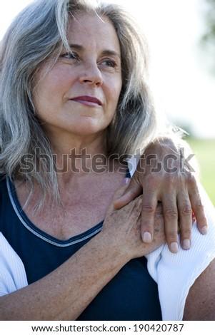 Senior woman holding her man's hand - stock photo