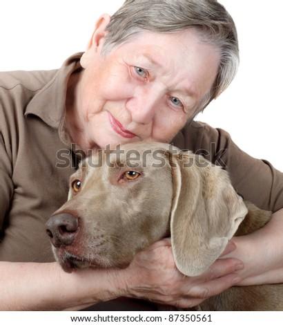 Senior woman hugging and comforting  dog - stock photo