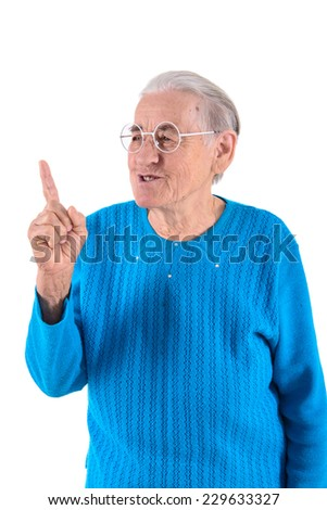 senior woman in glasses thumbs up.portrait isolated on white background - stock photo