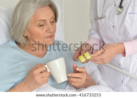Senior woman in hospital - stock photo