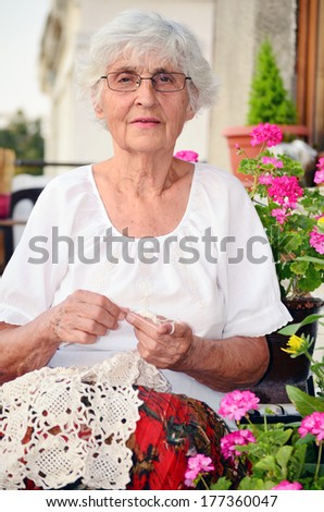 senior  woman knitting  - stock photo