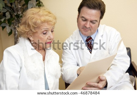 Senior woman learns from her doctor that her insurance won't cover treatment. - stock photo