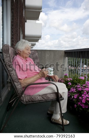 Senior woman on a coffee break - stock photo