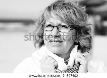 Senior Woman On Winter Beach - stock photo