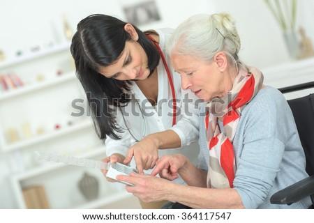 Senior woman organising her medication - stock photo
