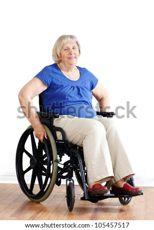 Senior woman patient in a wheelchair on white. - stock photo