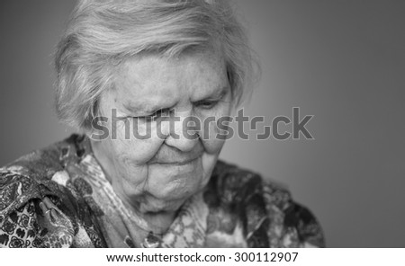 Senior woman pensive and worried. Black and white. - stock photo