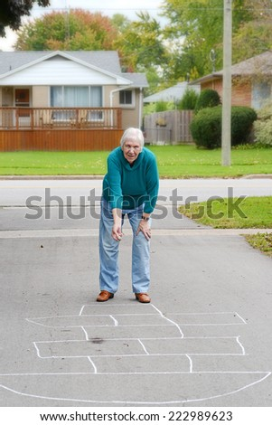 senior woman playing child's game - stock photo