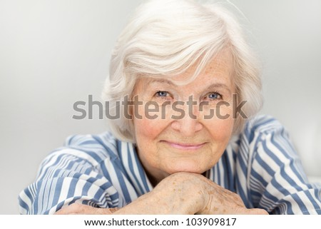 Senior woman portrait, on  grey  background with white hair - stock photo