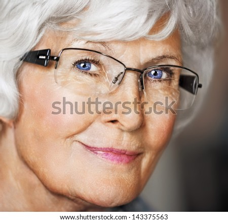 Senior woman portrait with eyeglasses - stock photo