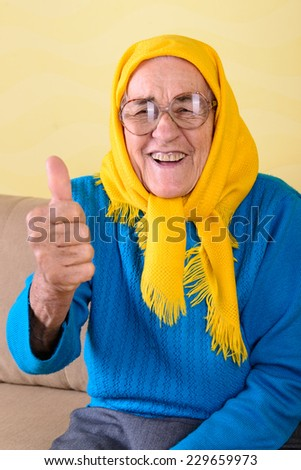 senior woman sitting on the sofa  - stock photo