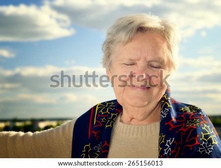 Senior woman smiling. - stock photo