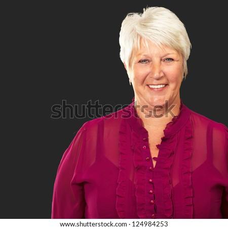 Senior Woman Smiling Isolated On Black Background - stock photo
