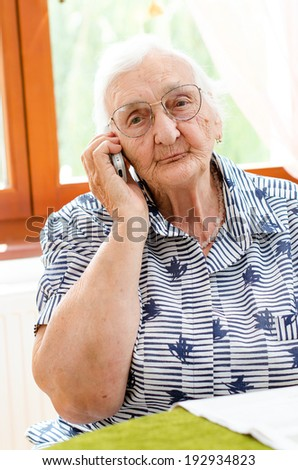 Senior woman talking on mobile phone  - stock photo