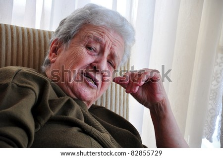 senior woman telling something - stock photo