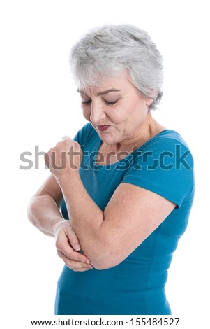 Senior woman touching her elbow itching her skin. - stock photo