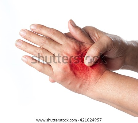 Senior woman touching her injured hand on white background,suffering pain concept - stock photo