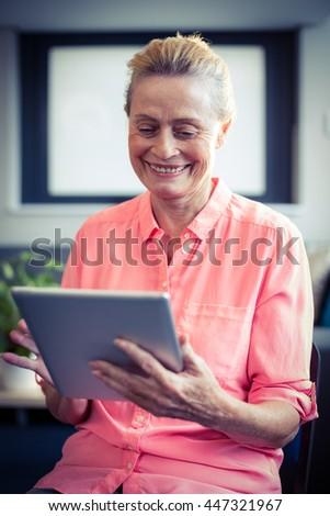 Senior woman using digital tablet at home - stock photo