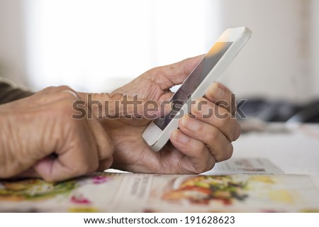Senior woman Using mobile phone at home  - stock photo