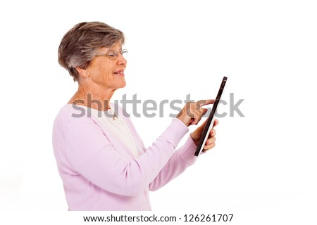 senior woman using tablet computer isolated on white - stock photo