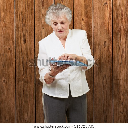 Senior woman using tablet, indoor - stock photo