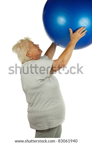 Senior woman with a fit ball on white background - stock photo