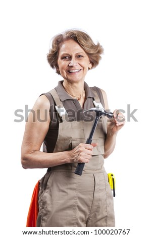 Senior woman with a hammer (white background) - stock photo
