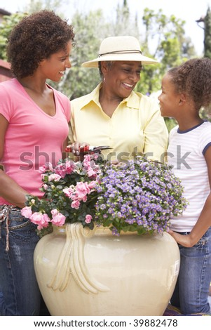 Senior Woman With Adult Daughter Gardening Together - stock photo