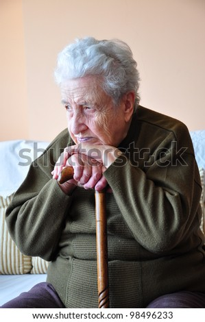 senior woman with cane - stock photo