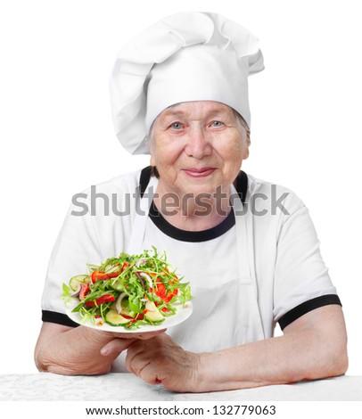 Senior woman  with fresh salad isolated on white - stock photo